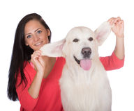 Beautiful girl with her golden retriever dog Royalty Free Stock Images