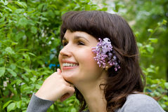 Beautiful girl, in her hair lilac Royalty Free Stock Photo