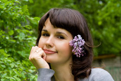 Beautiful girl, in her hair lilac Royalty Free Stock Images