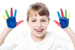Beautiful girl with her hands in the paint Royalty Free Stock Image