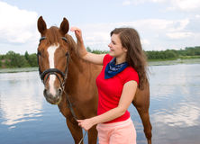 Beautiful girl and her handsome horse. Stock Photo