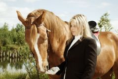 Beautiful girl and her handsome horse Royalty Free Stock Photo