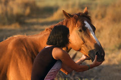 Beautiful girl and her handsome horse Royalty Free Stock Photos