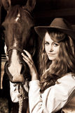 Beautiful girl with her horse stock images