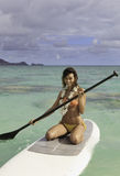 Beautiful girl on her paddle board Royalty Free Stock Photography