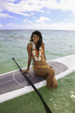 Beautiful girl on her paddle board Royalty Free Stock Image