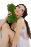 Beautiful girl with her plush toy Stock Images