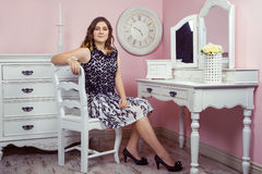 Beautiful girl in her room and posing near dressing table, Stock Image