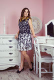 Beautiful girl in her room and posing near dressing table, Royalty Free Stock Photos