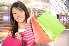Beautiful girl with her shopping bags Stock Photography