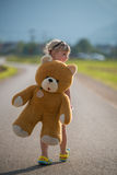 Beautiful girl and her teddy bear Royalty Free Stock Photography