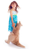 Beautiful girl with her toy t kangaroo Royalty Free Stock Photography