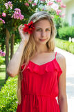 Beautiful girl with hibiscus flower in her hair Stock Photos