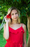 Beautiful girl with hibiscus flower in her hair Stock Photo