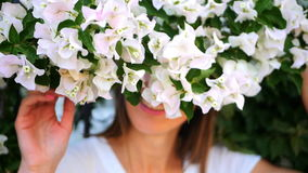 Beautiful girl hiding behind the bush stock footage