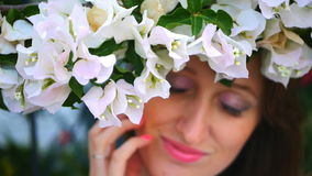Beautiful girl hiding behind the bush stock video footage