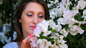 Beautiful girl hiding behind the bush stock video