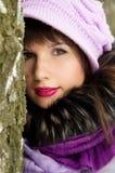 Beautiful girl hiding behind the tree Stock Photo