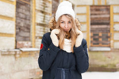 Beautiful girl hiding in knitted scarf. Outdoors portrait. Royalty Free Stock Image