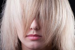 Beautiful girl hiding in a strand of hair Royalty Free Stock Image