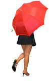 Beautiful girl hiding under red umbrella Royalty Free Stock Photography