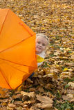 Beautiful girl hiding under an umbrella Stock Image