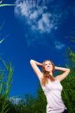 Beautiful girl among high grass of meadow Stock Photography