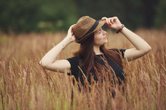 Beautiful girl in high grass portrait Stock Images
