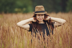 Beautiful girl in high grass portrait Stock Photo