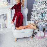 Beautiful girl in high heels shoes sitting in a chair near the C royalty free stock image