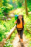 Beautiful girl in a hike and green forest Stock Photo