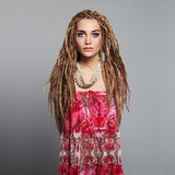 Beautiful girl hippies with dreadlocks. pretty young woman. Ethnic culture beautiful girl hippies with dreadlocks. pretty young woman with African braids Royalty Free Stock Photography