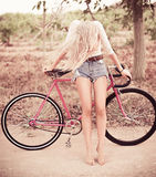 Beautiful girl hipster bike Stock Photography