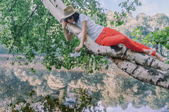 Beautiful girl hipster in the park Stock Photos