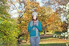 Beautiful girl hold an apple on sunny autumn-day stock photography