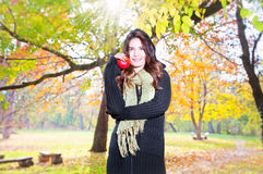 Beautiful girl hold an apple on sunny day in park royalty free stock image