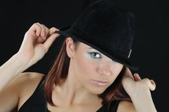 Beautiful Girl Hold On The Hat Stock Image