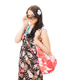 Beautiful girl holding bag taking off sunglasses Royalty Free Stock Photo