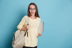 Beautiful girl holding bagpack and notebook Stock Photography