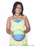 Beautiful girl holding a ball Stock Photo