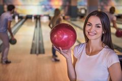 Friends playing bowling Royalty Free Stock Image