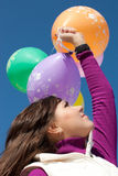 Beautiful girl holding balloons Stock Images