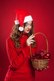 Beautiful girl holding basket with christmas tree decorations Stock Image