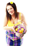 Beautiful girl holding basket of colored eggs Royalty Free Stock Photos