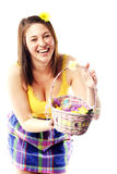 Beautiful girl holding basket of colored eggs Stock Photography