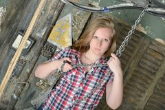 Beautiful girl holding a big metal chain Stock Photos