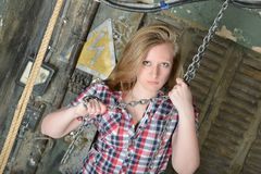 Beautiful girl holding a big metal chain Royalty Free Stock Images