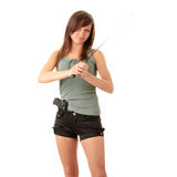 Beautiful girl holding a black gun Royalty Free Stock Image