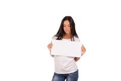 Beautiful girl holding a blank billboard Stock Photos