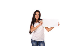 Beautiful girl holding a blank billboard Stock Photo